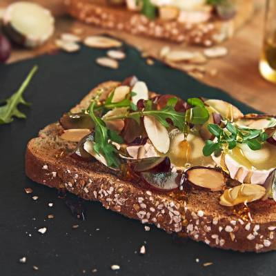 Goat cheese toast with honey and almonds